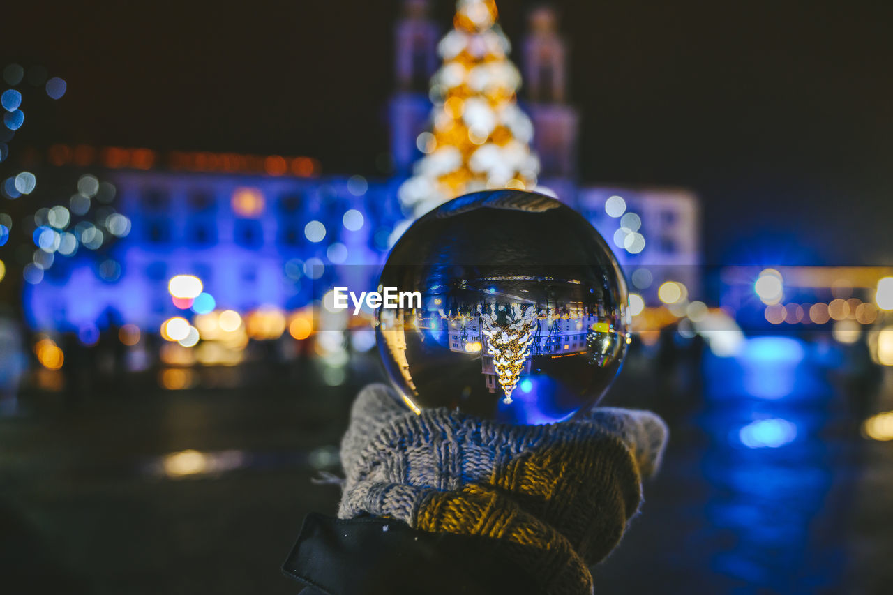 illuminated, night, focus on foreground, architecture, city, one person, close-up, building exterior, portrait, real people, built structure, headshot, outdoors, glowing, leisure activity, lifestyles, reflection, human body part, nature, nightlife
