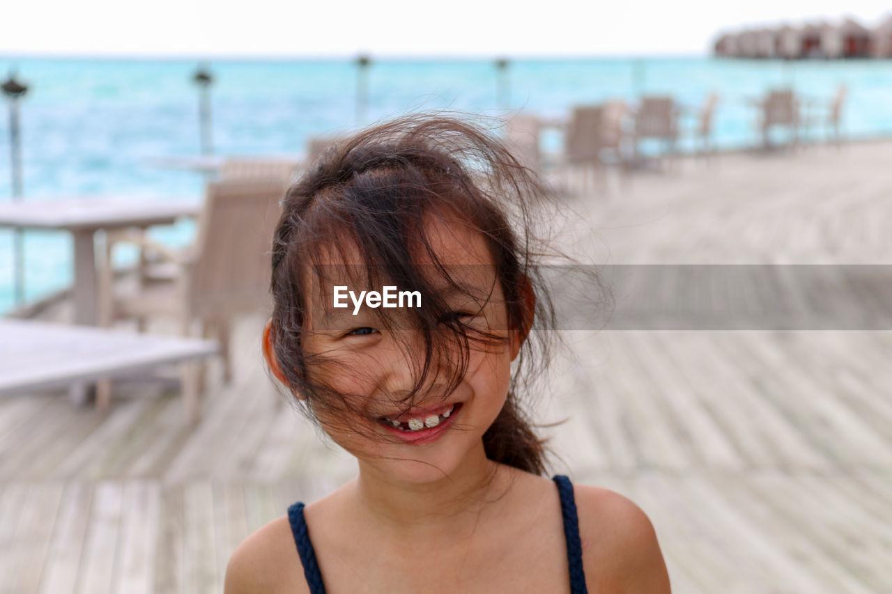 Portrait of smiling girl at promenade