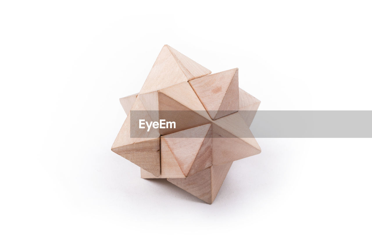 Close up of wooden toy on white background
