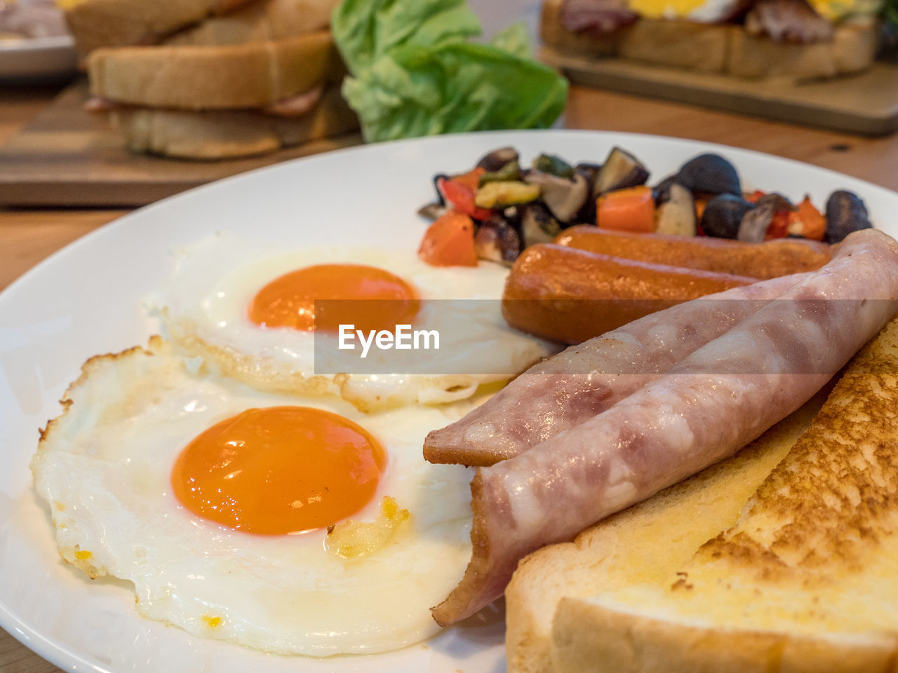 food, food and drink, egg, fried egg, ready-to-eat, meat, healthy eating, close-up, freshness, table, fried, indoors, plate, still life, meal, breakfast, wellbeing, pork, vegetable, processed meat, no people, egg yolk, sunny side up