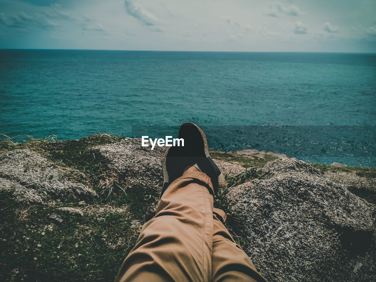 sea, water, personal perspective, low section, horizon, one person, human leg, horizon over water, real people, leisure activity, beauty in nature, nature, rock, relaxation, body part, solid, scenics - nature, rock - object, day, outdoors, jeans