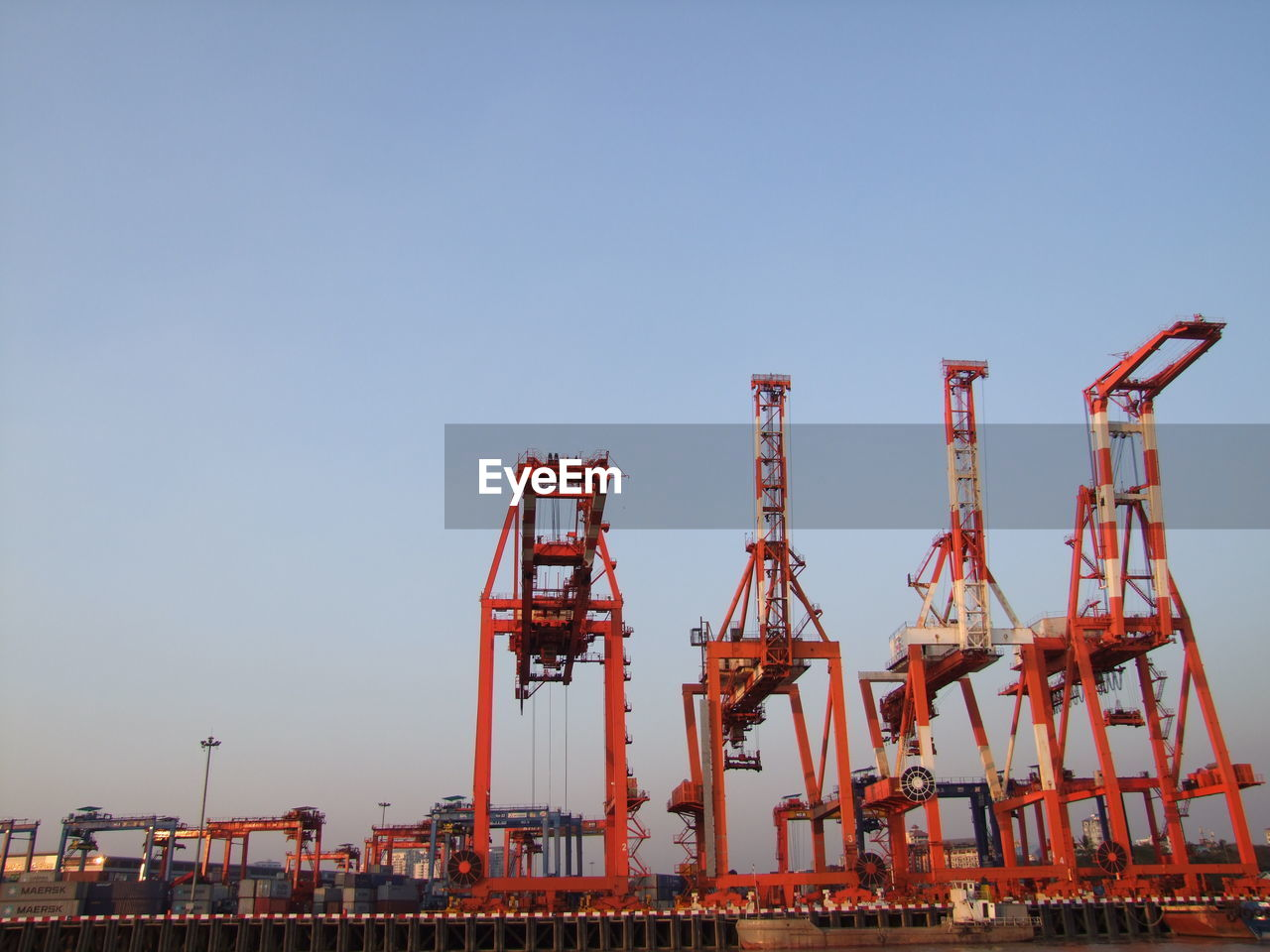 Cranes against clear sky