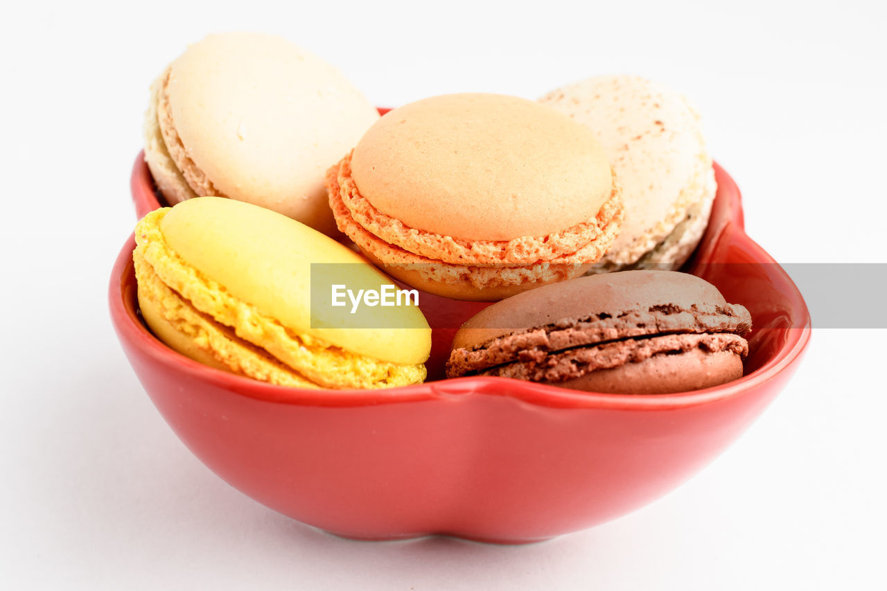 food and drink, food, sweet food, still life, sweet, white background, indulgence, freshness, dessert, indoors, studio shot, close-up, unhealthy eating, temptation, ready-to-eat, macaroon, no people, group of objects, chocolate, variation