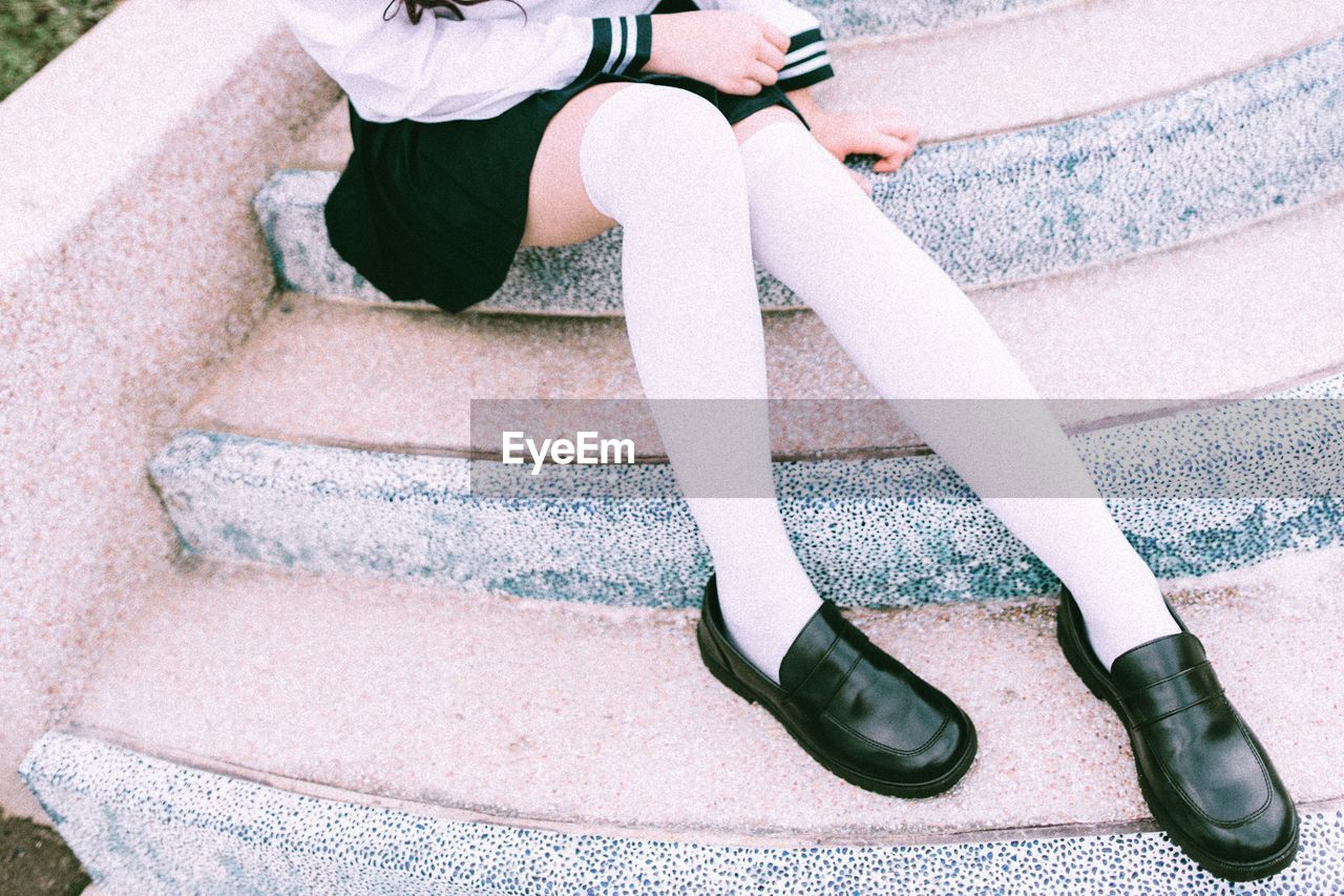 Low Section Of Teenage Girl Wearing Black Shoes