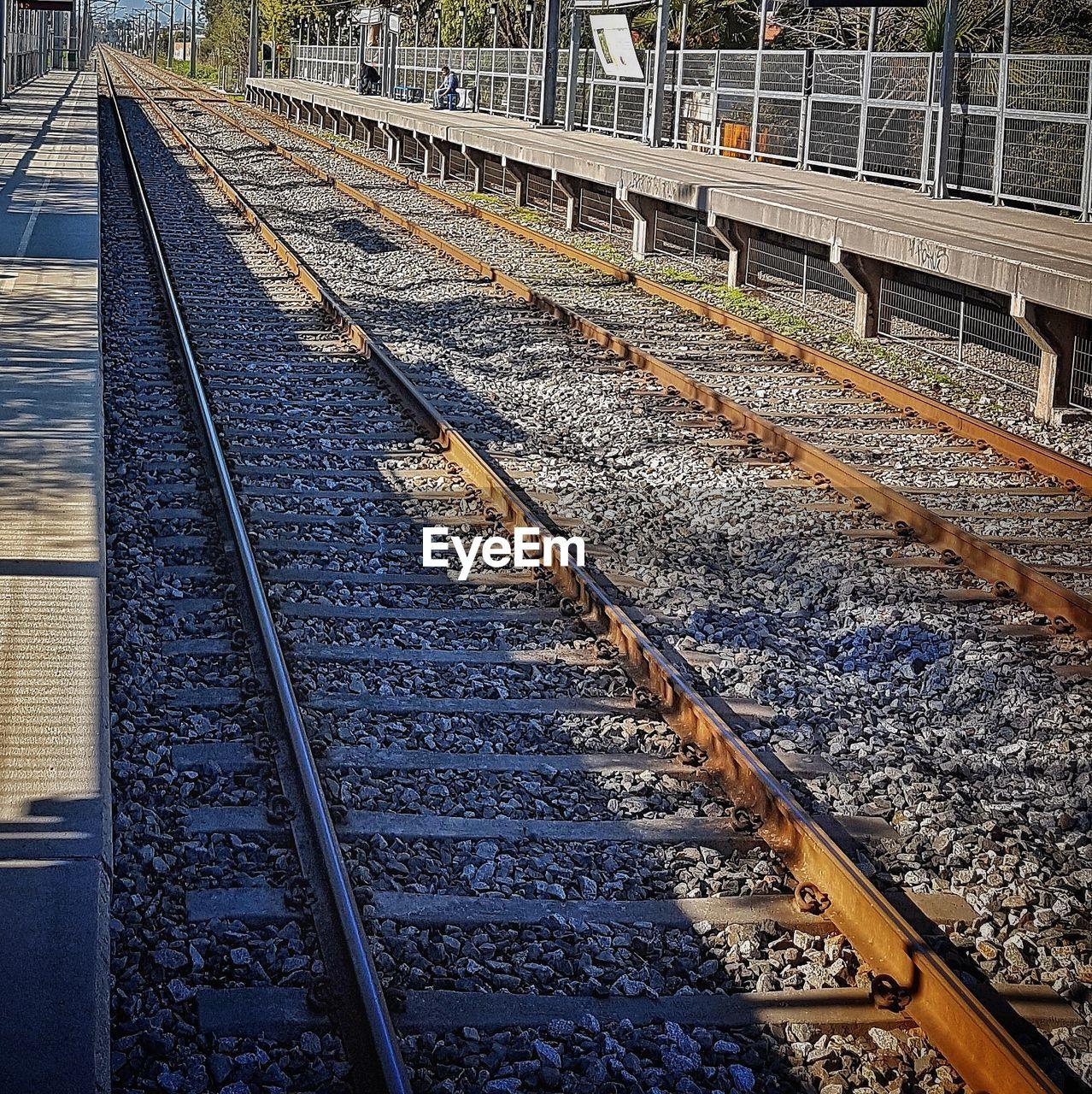 railroad track, rail transportation, transportation, railroad tie, public transportation, day, outdoors, railway track, railroad station, railroad station platform, railroad, train - vehicle, no people, nature