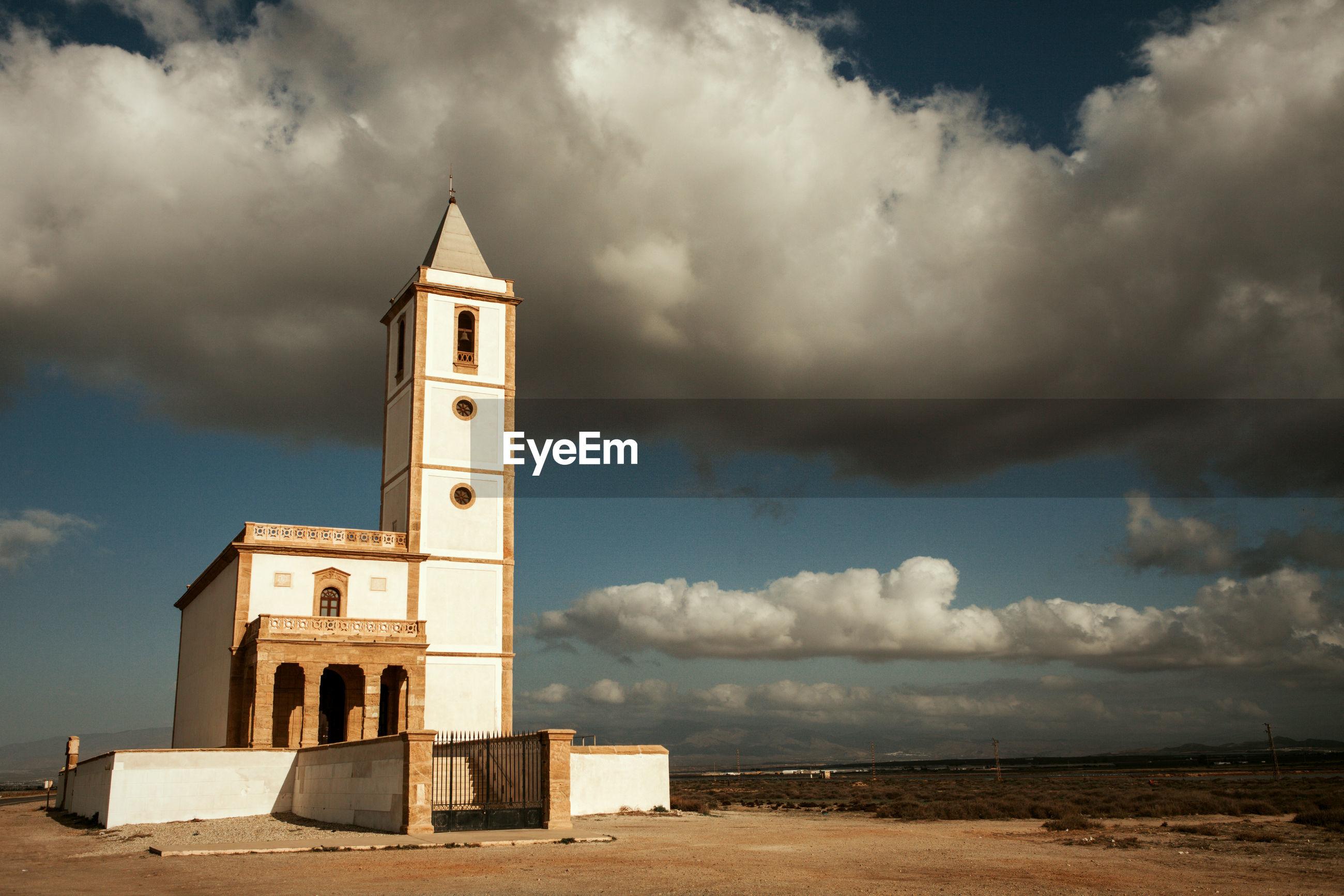 CHURCH ON BEACH AGAINST SKY