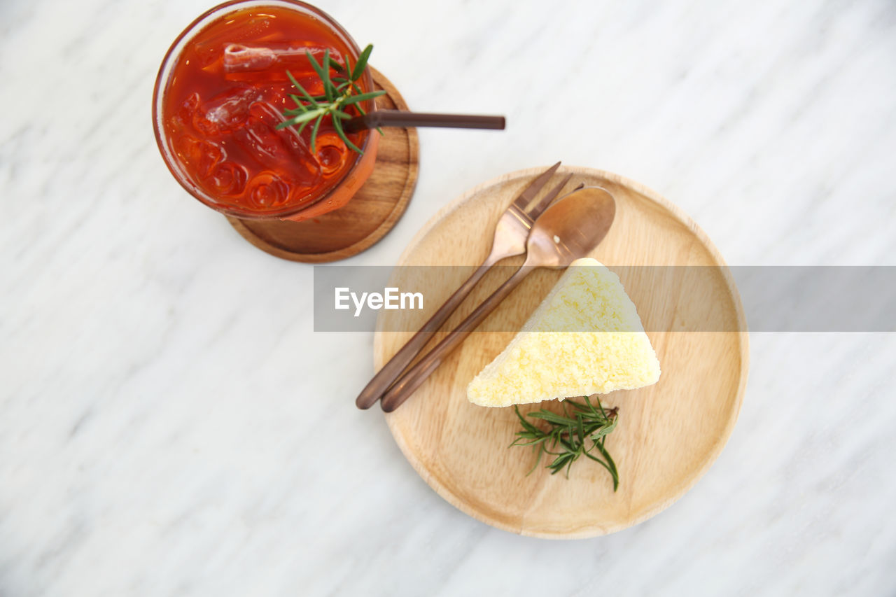 food, food and drink, freshness, high angle view, table, still life, healthy eating, indoors, wellbeing, no people, kitchen utensil, eating utensil, spoon, ready-to-eat, close-up, wood - material, herb, vegetable, slice, fruit