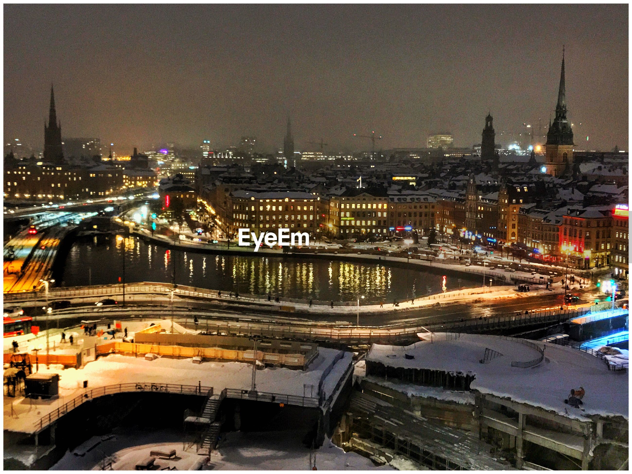city, cityscape, illuminated, night, architecture, building exterior, built structure, river, travel destinations, bridge - man made structure, outdoors, aerial view, sky, tree, urban skyline, no people