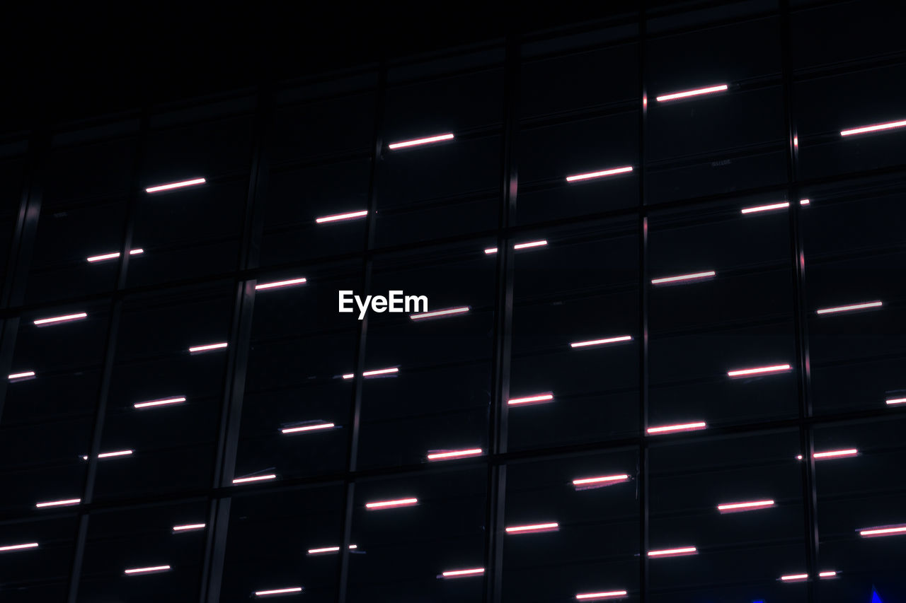 backgrounds, pattern, indoors, full frame, no people, illuminated, in a row, metal, shape, built structure, repetition, design, night, architecture, side by side, glowing, technology, modern, close-up, geometric shape, black background, silver colored, ceiling