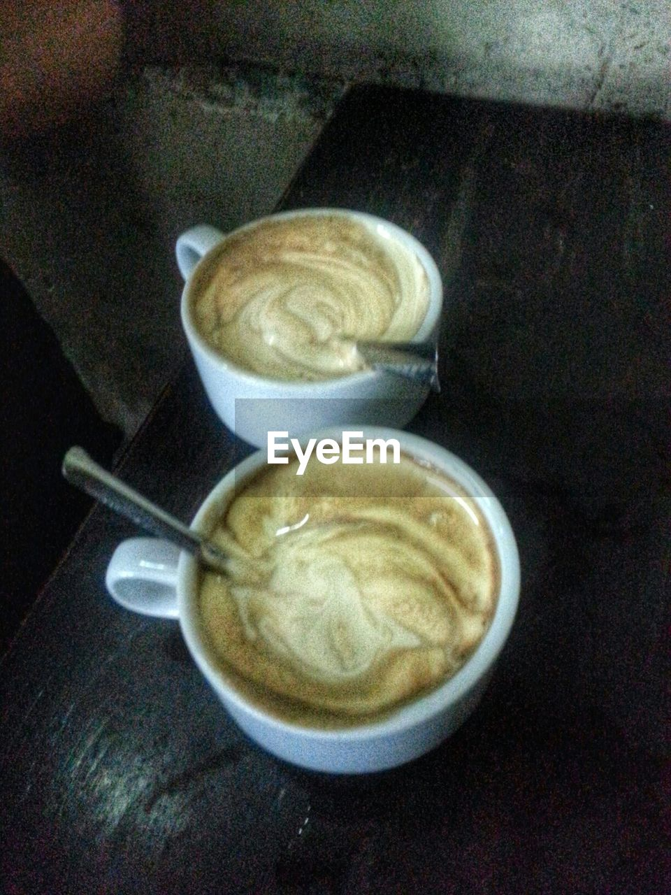 coffee cup, coffee - drink, food and drink, drink, refreshment, table, cappuccino, indoors, frothy drink, froth art, no people, freshness, high angle view, food, breakfast, close-up, bowl, directly above, latte, healthy eating, day, ready-to-eat