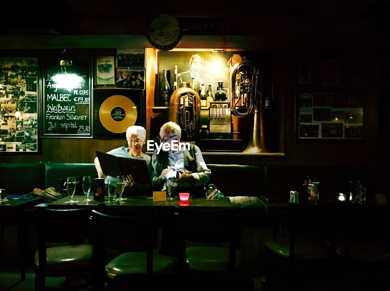 table, restaurant, food and drink, sitting, two people, indoors, real people, illuminated, lifestyles, togetherness, cafe, drink, leisure activity, customer, women, chair, men, night, friendship, food, people