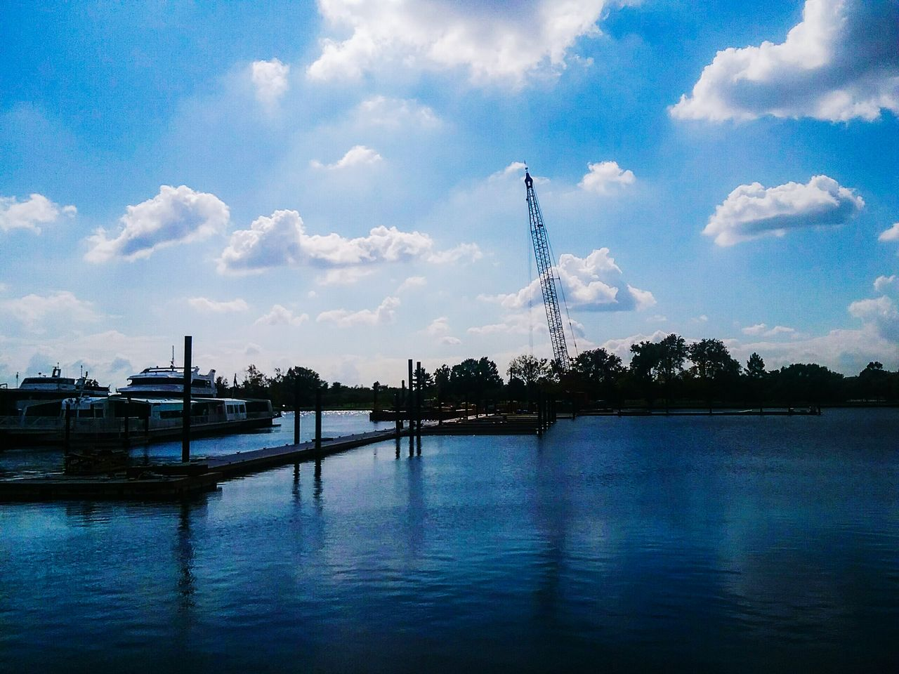 water, sky, cloud - sky, built structure, waterfront, river, architecture, outdoors, day, travel destinations, transportation, no people, nature, tree, ferris wheel, building exterior, beauty in nature