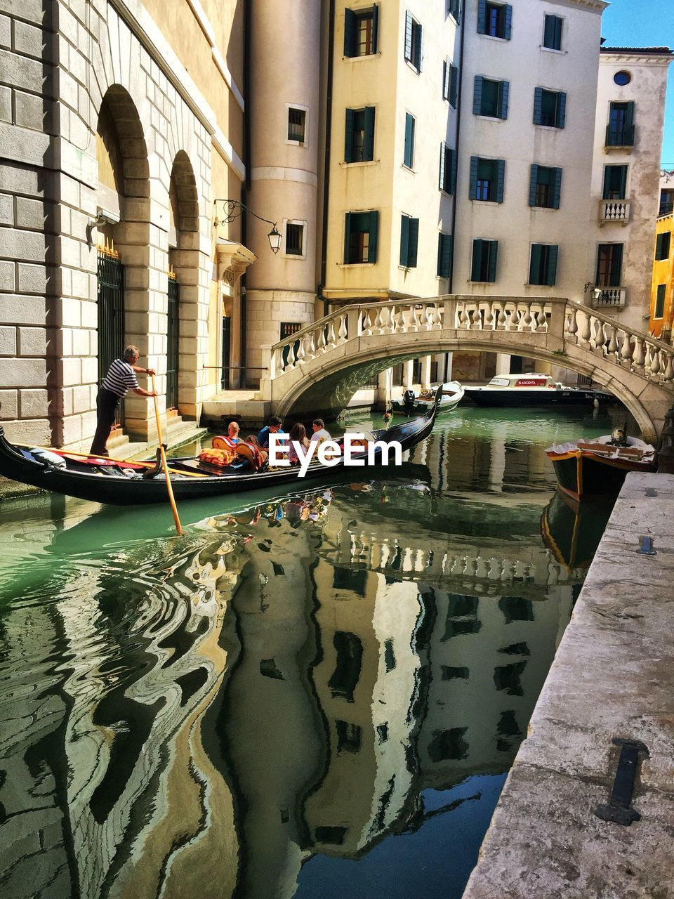 built structure, water, nautical vessel, architecture, transportation, mode of transportation, canal, building exterior, bridge, connection, bridge - man made structure, gondola - traditional boat, incidental people, day, arch, waterfront, nature, travel destinations, city, outdoors, arch bridge