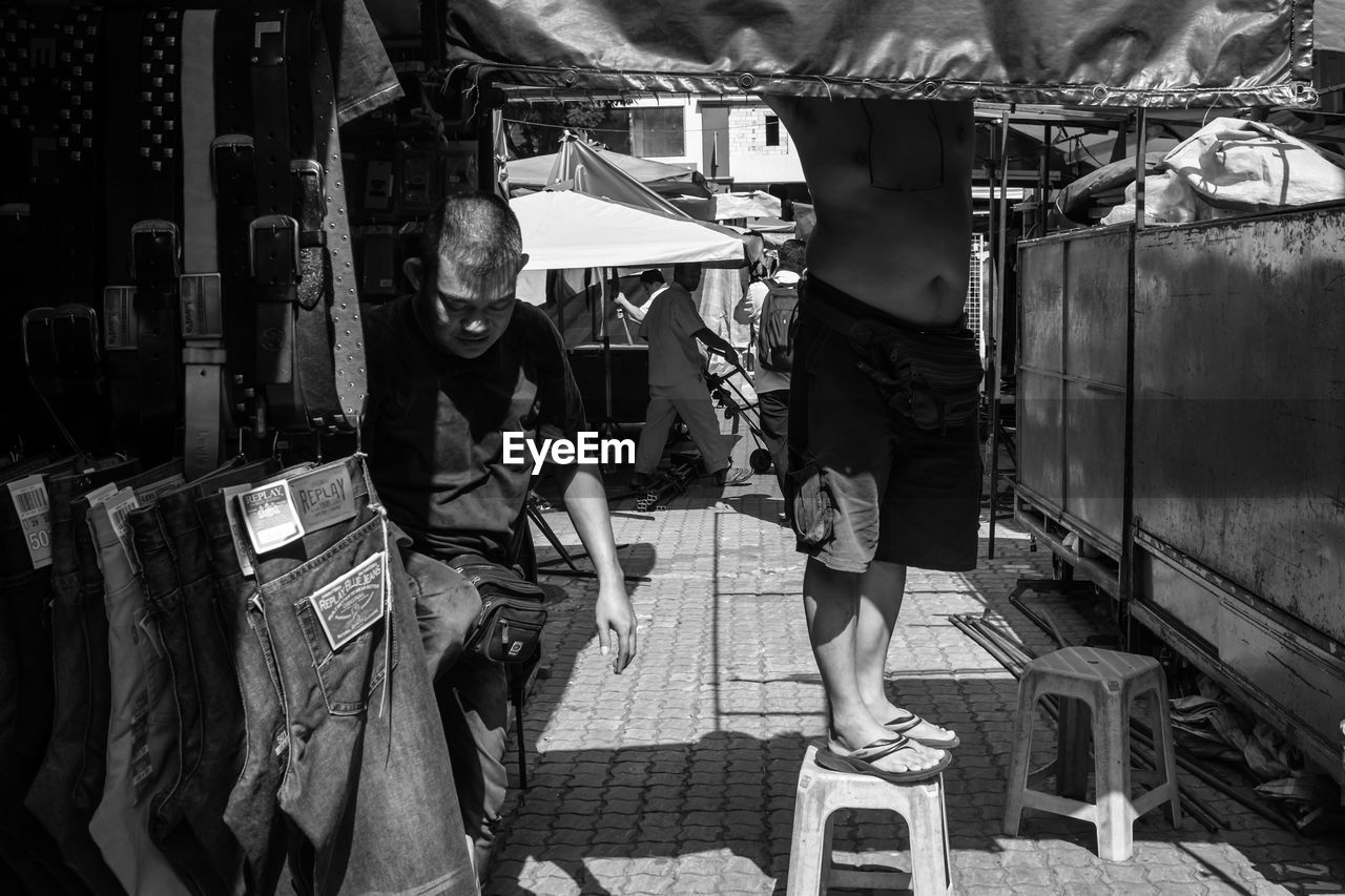 real people, one person, standing, market, outdoors, men, women, day, full length, low section, people