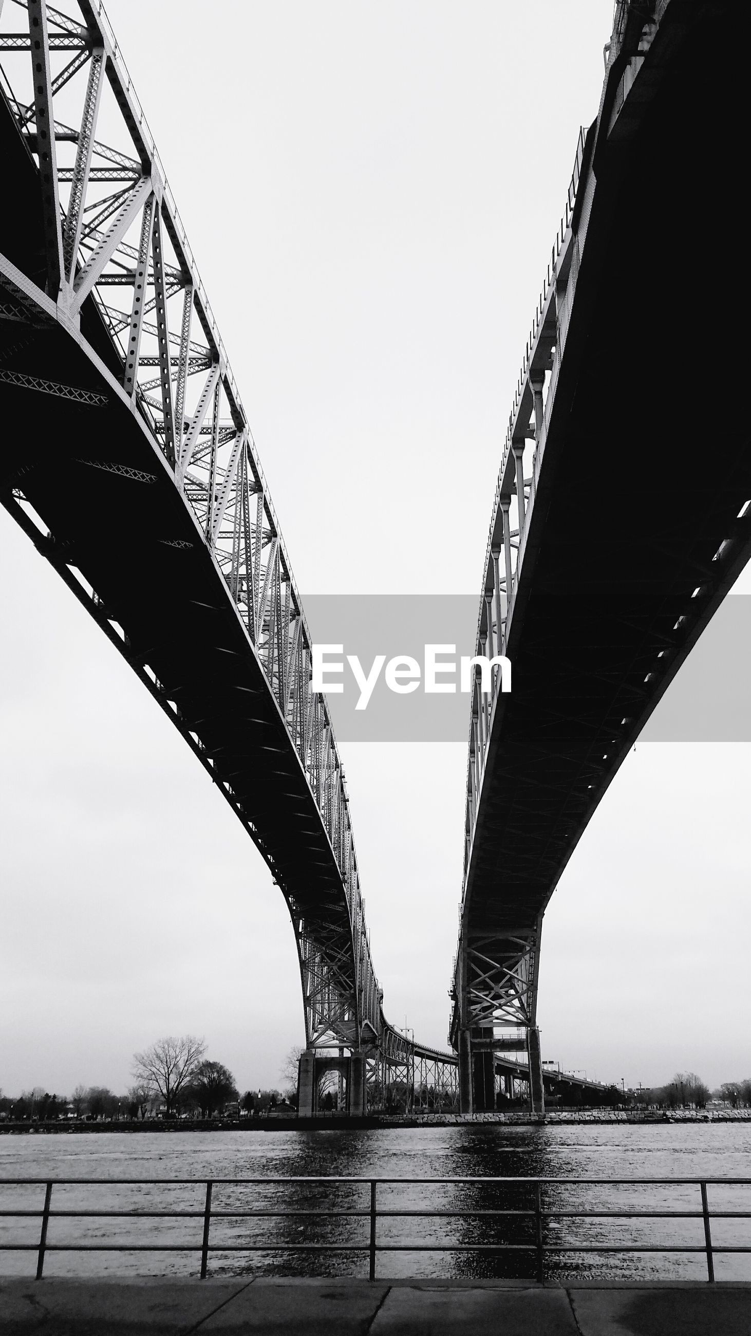 LOW ANGLE VIEW OF GOLDEN BRIDGE AGAINST SKY