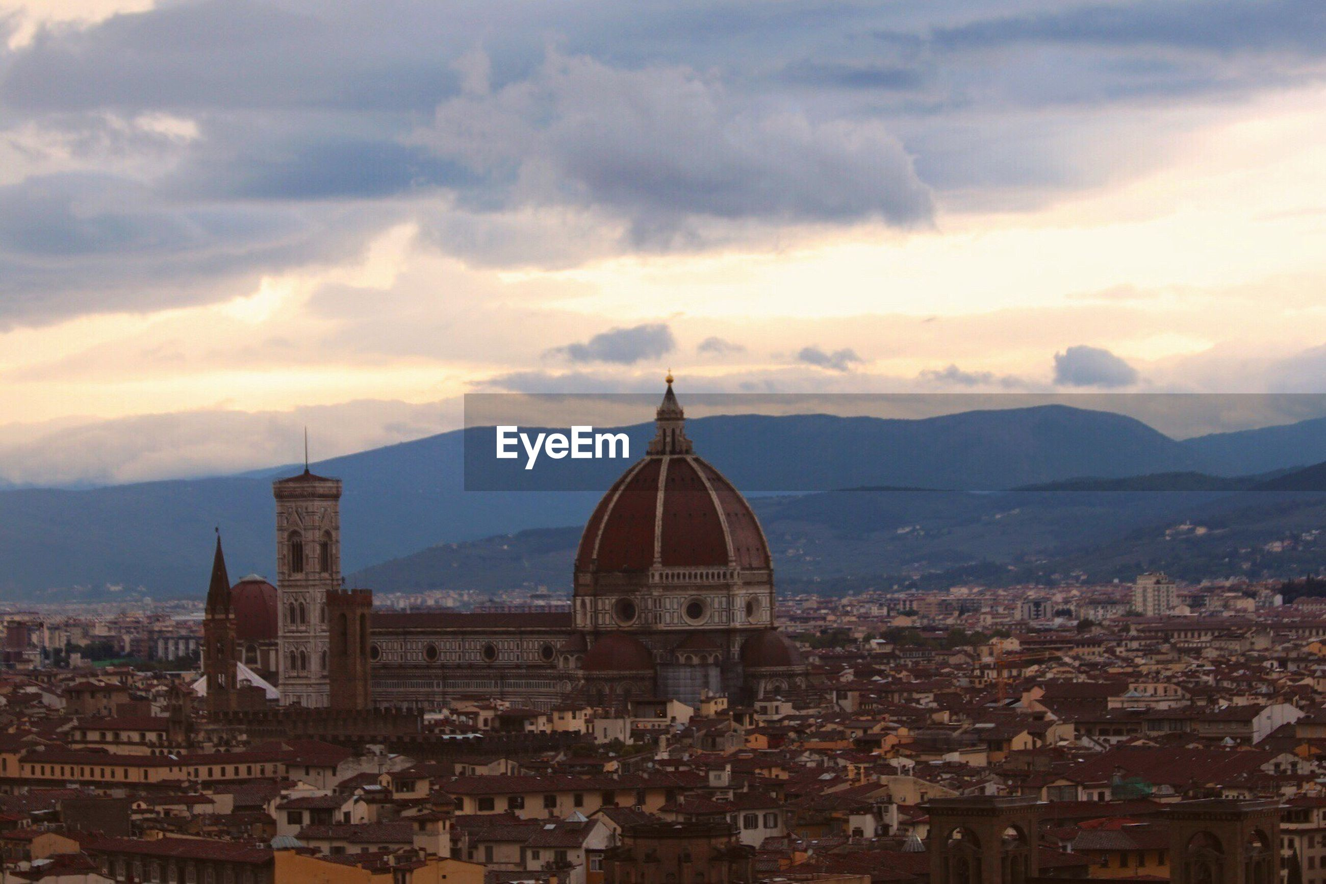 Duomo santa maria del fiore in city against cloudy sky during sunset
