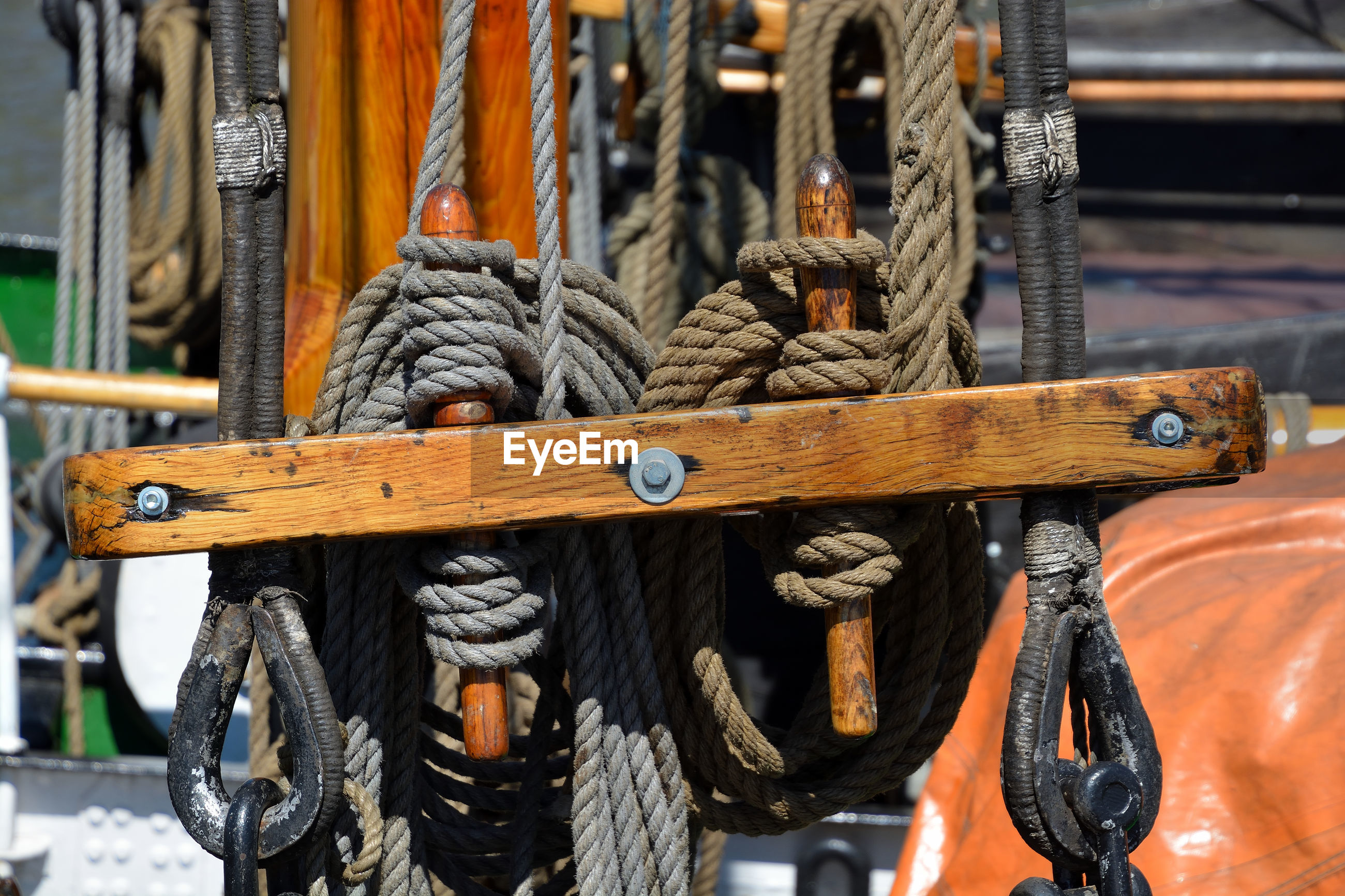 CLOSE-UP OF ROPES TIED UP ON METAL