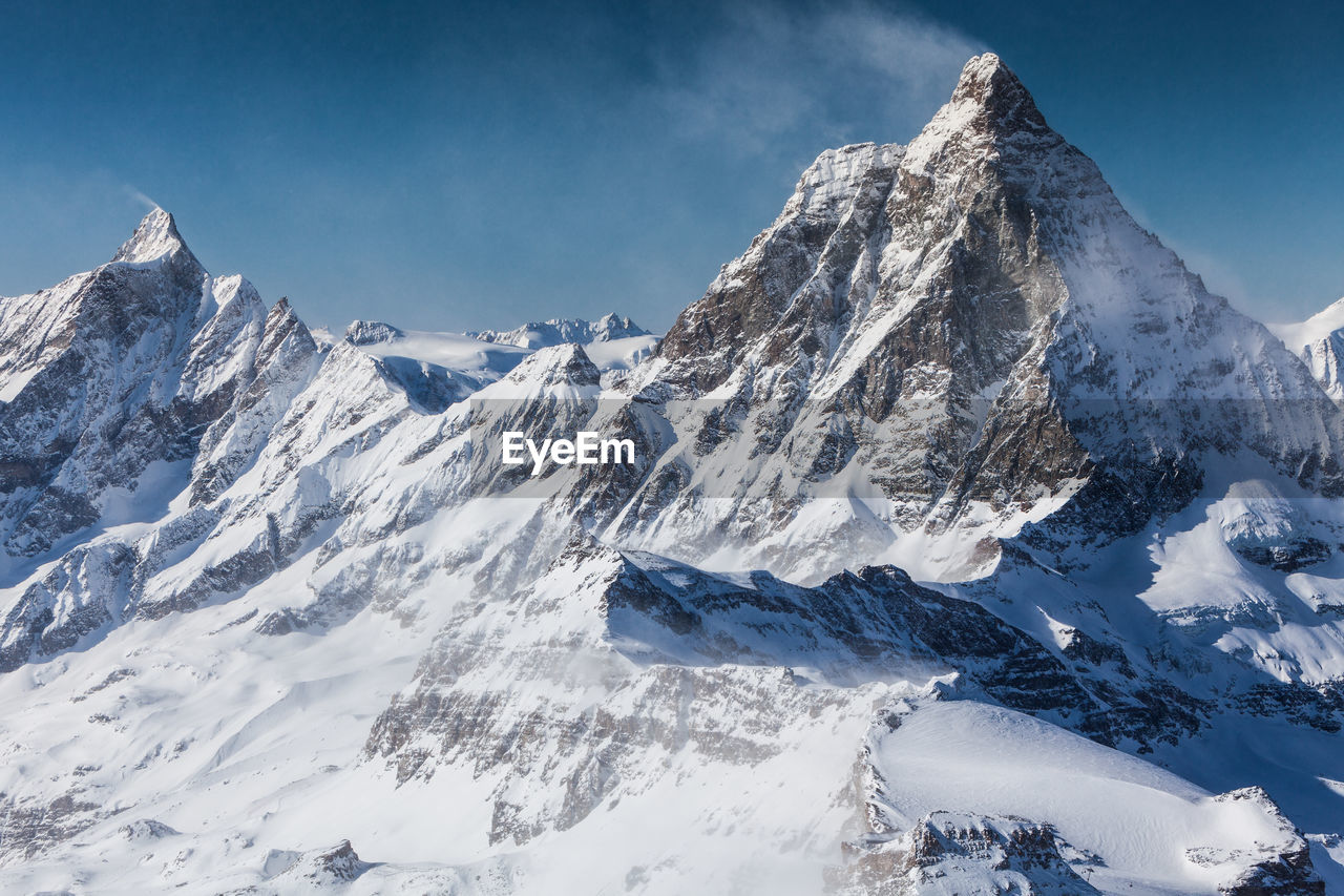 Scenic view of snowcapped mountains against sky. view from klein matterhorn, swiss alps