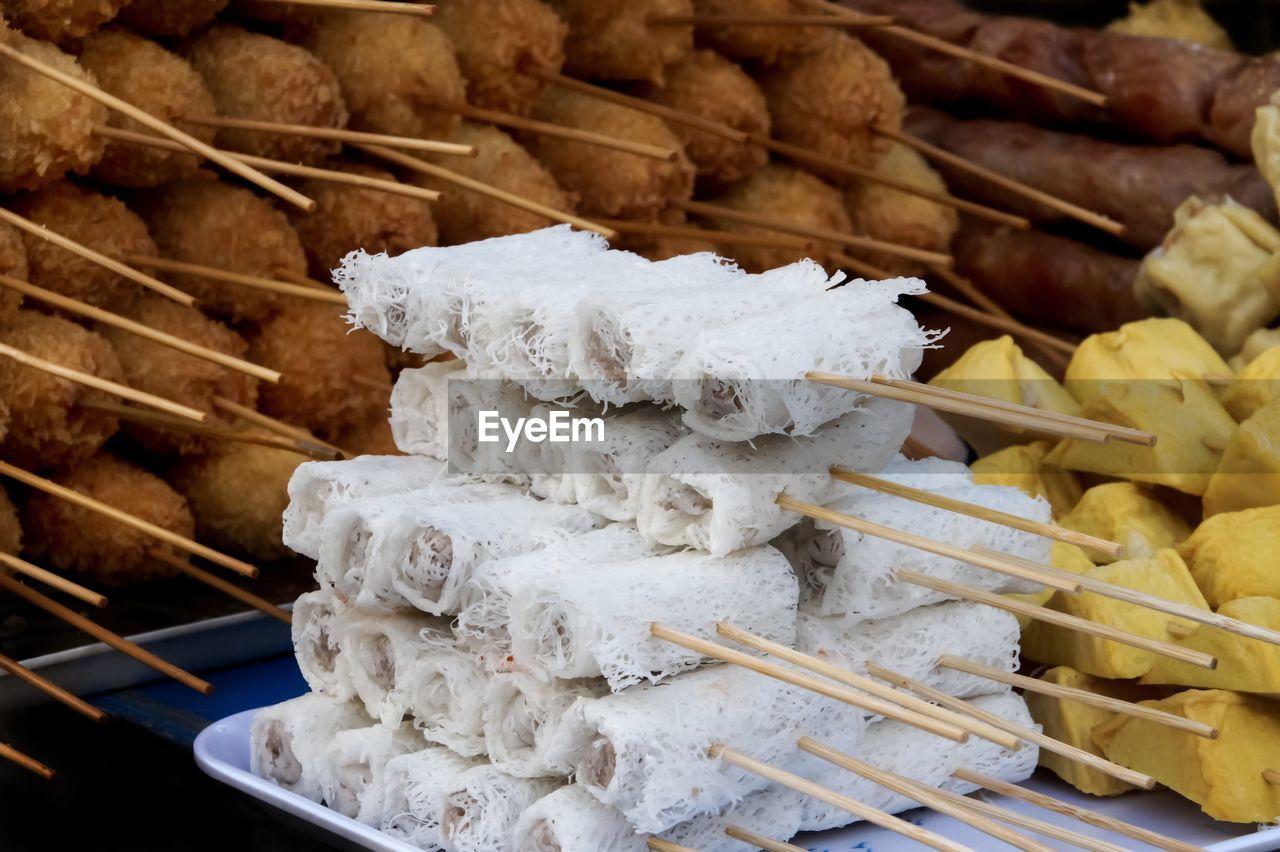 Close-Up Of Skewed Food For Sale At Market