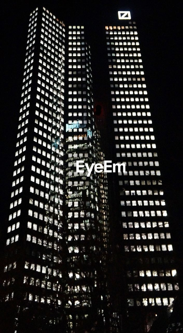 architecture, low angle view, skyscraper, illuminated, modern, built structure, night, building exterior, no people, travel destinations, city, indoors