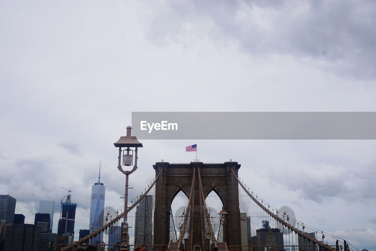Brooklyn Bridge Against Cloudy Sky