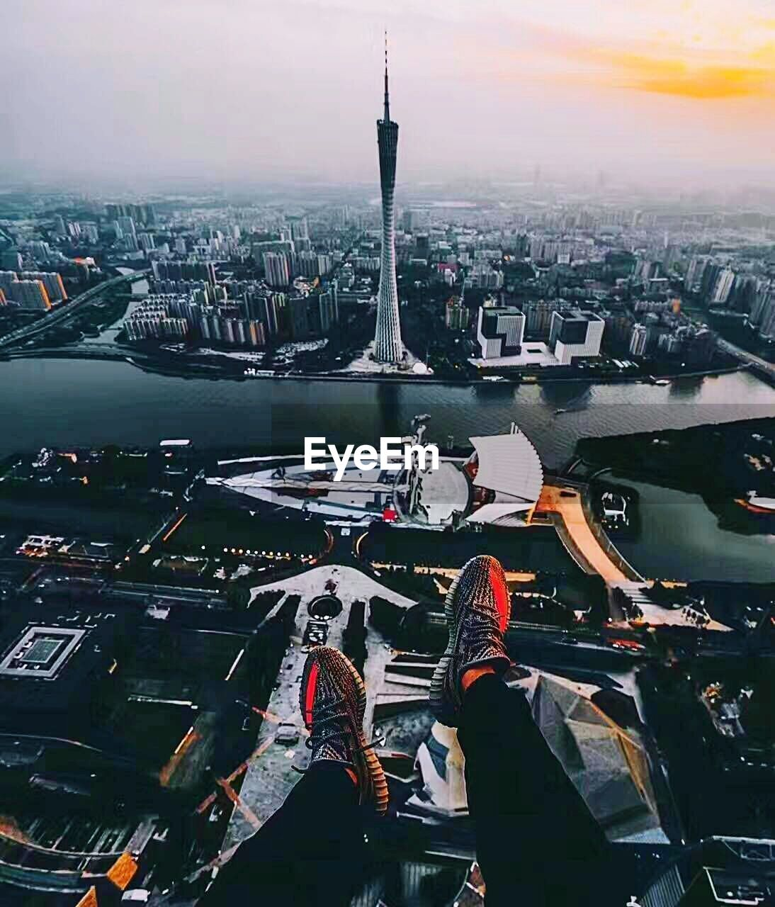 architecture, city, travel destinations, built structure, tall - high, building exterior, cityscape, tourism, travel, skyscraper, tower, high angle view, outdoors, no people, transportation, aerial view, day, urban skyline, sky, modern