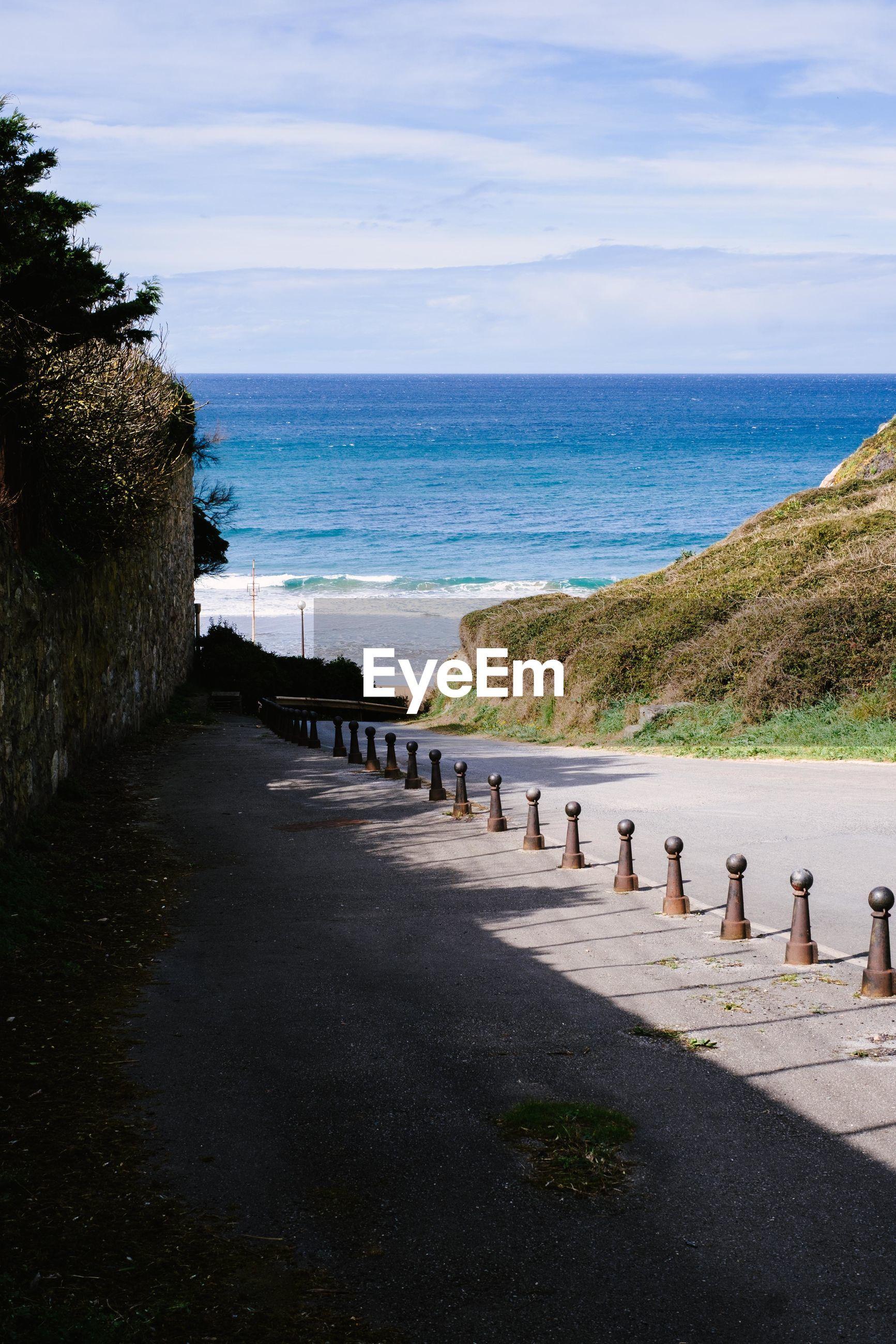 FOOTPATH LEADING TOWARDS SEA AGAINST SKY