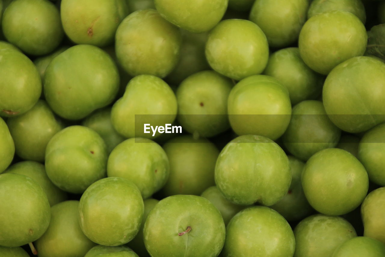 Full Frame Shot Of Granny Smith Apples For Sale At Market