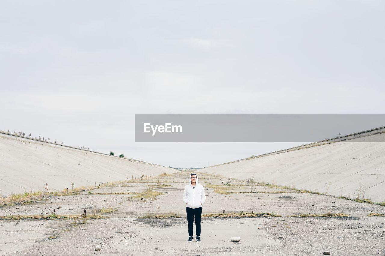 Full Length Of Man Standing On Ground Against Sky
