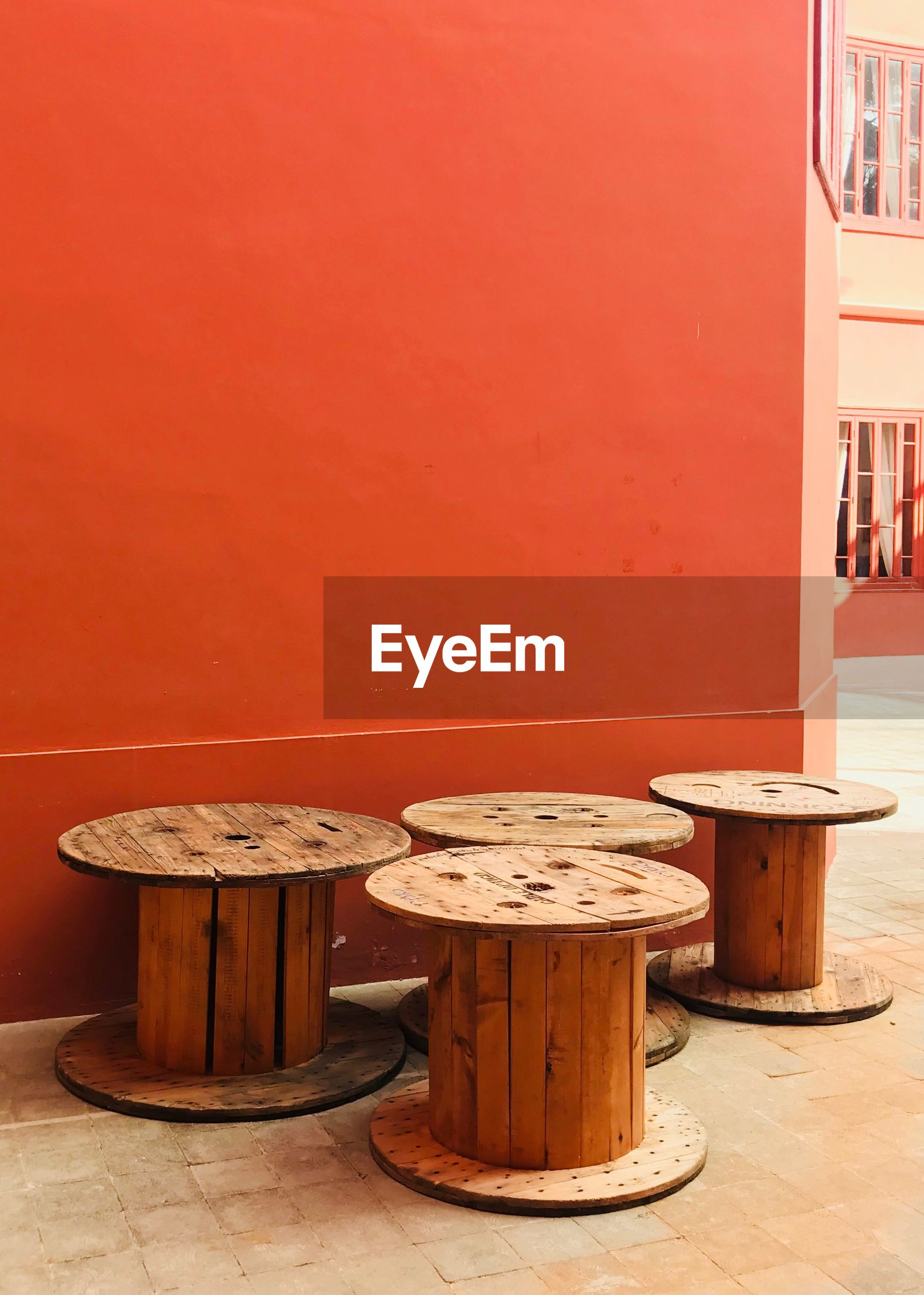 Wooden stools by wall