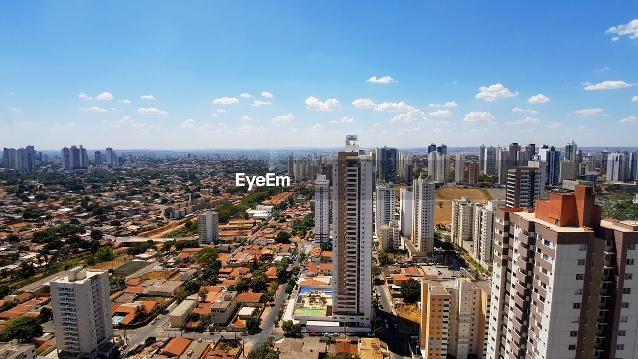 building exterior, city, architecture, built structure, building, cityscape, sky, office building exterior, residential district, skyscraper, crowd, tall - high, cloud - sky, high angle view, nature, crowded, day, modern, urban skyline, outdoors, financial district, apartment, settlement
