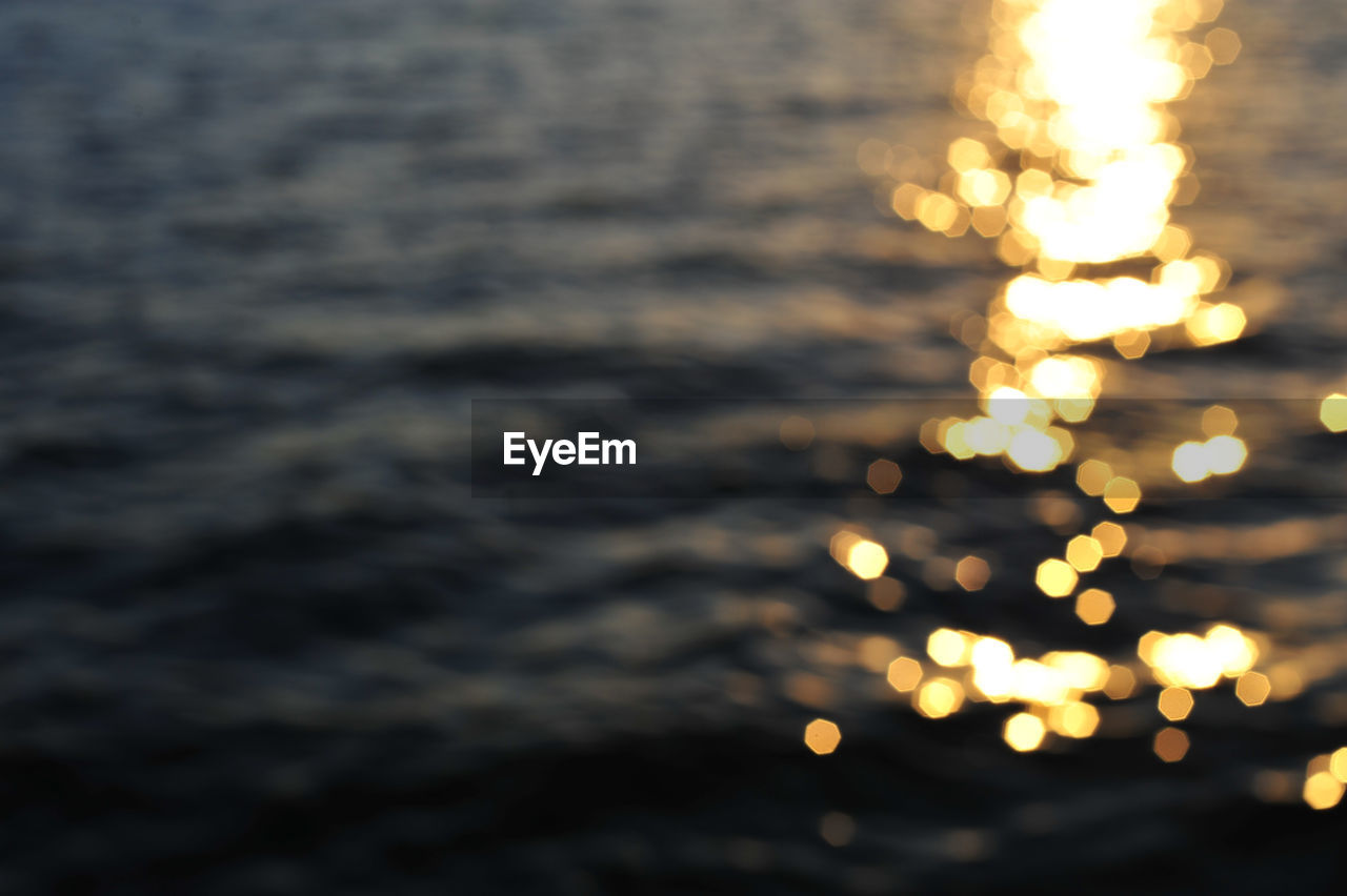 water, motion, no people, nature, illuminated, sea, glowing, outdoors, sunset, tranquility, beauty in nature, blurred motion, focus on foreground, scenics - nature, defocused, sky, land, orange color, waterfront