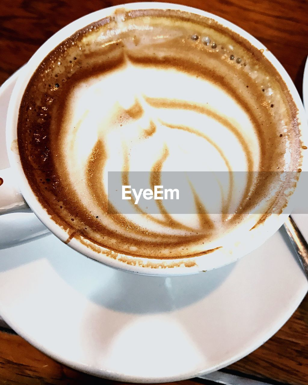 coffee cup, drink, refreshment, frothy drink, coffee - drink, food and drink, saucer, table, froth art, cappuccino, indoors, close-up, no people, freshness, latte, day