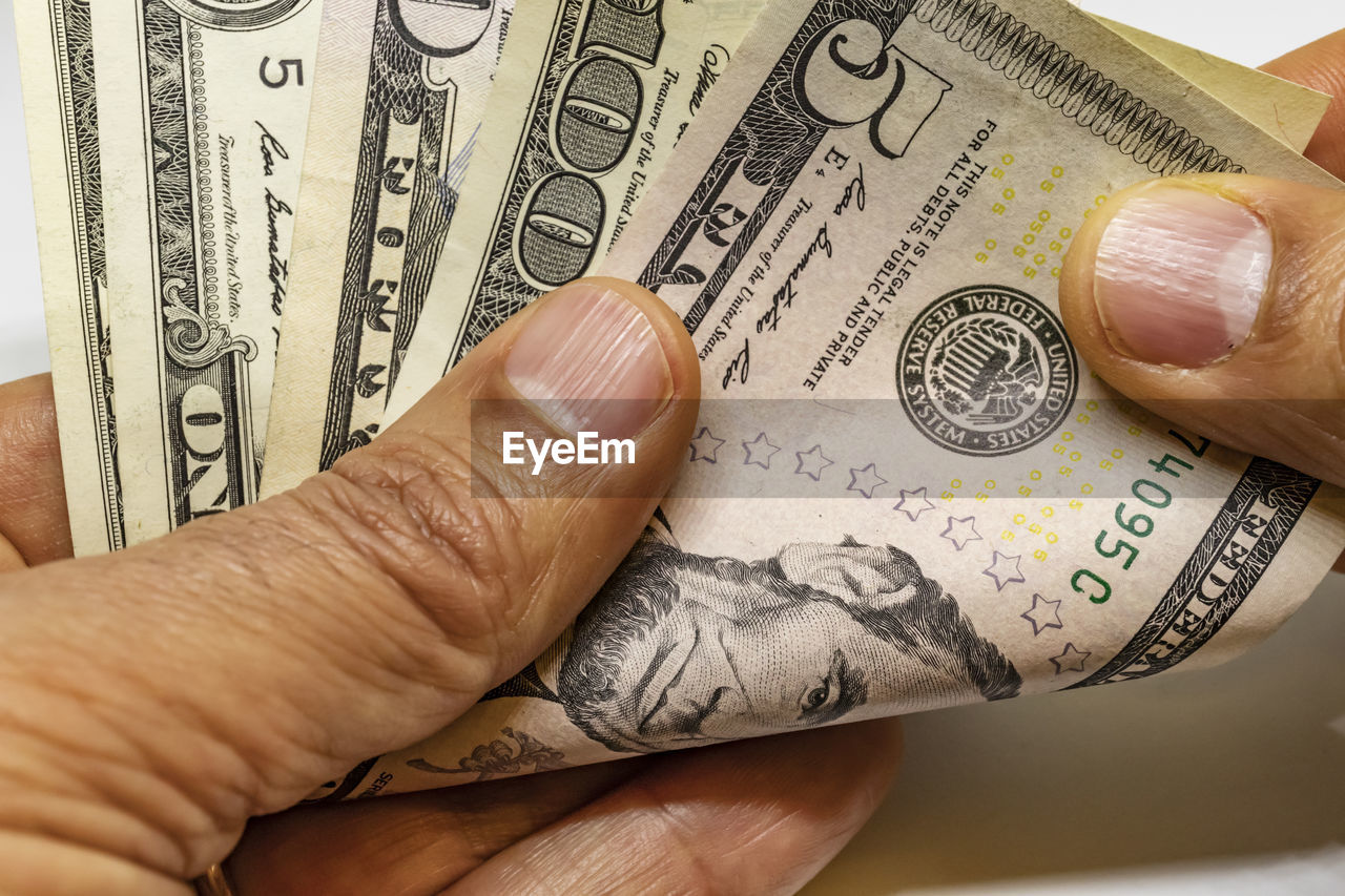 human hand, finance, hand, wealth, currency, human body part, business, paper currency, body part, paying, people, holding, finger, human finger, men, indoors, savings, success, dollar sign, buying, economy