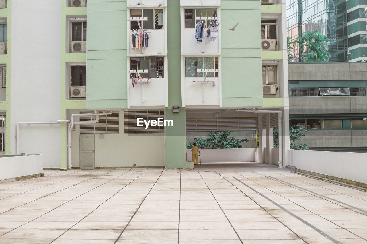 architecture, built structure, building exterior, building, window, entrance, no people, door, day, outdoors, city, flooring, glass - material, residential district, empty, absence, modern, footpath, balcony, transparent, tiled floor, apartment