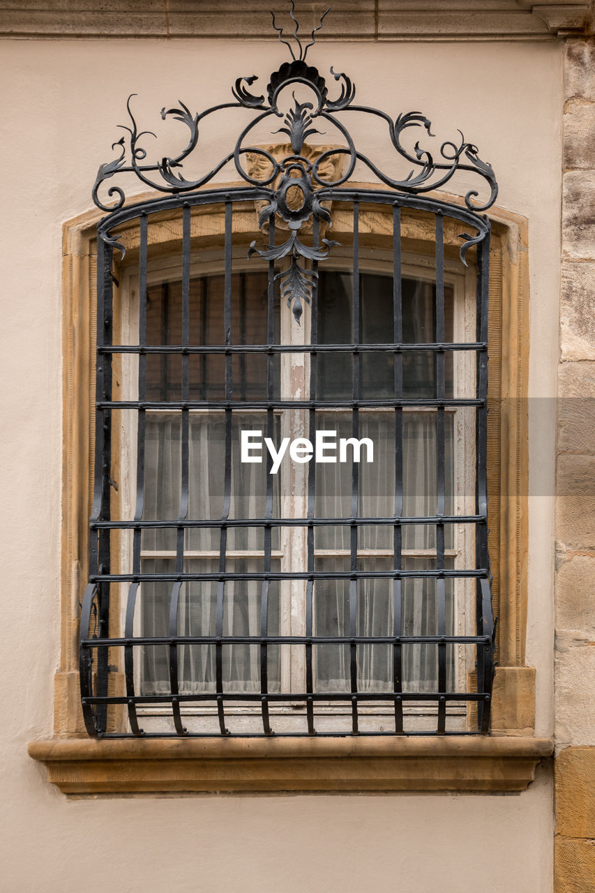 building exterior, architecture, built structure, no people, window, building, day, low angle view, metal, wrought iron, outdoors, house, entrance, safety, history, residential district, old, ornate, the past, gate