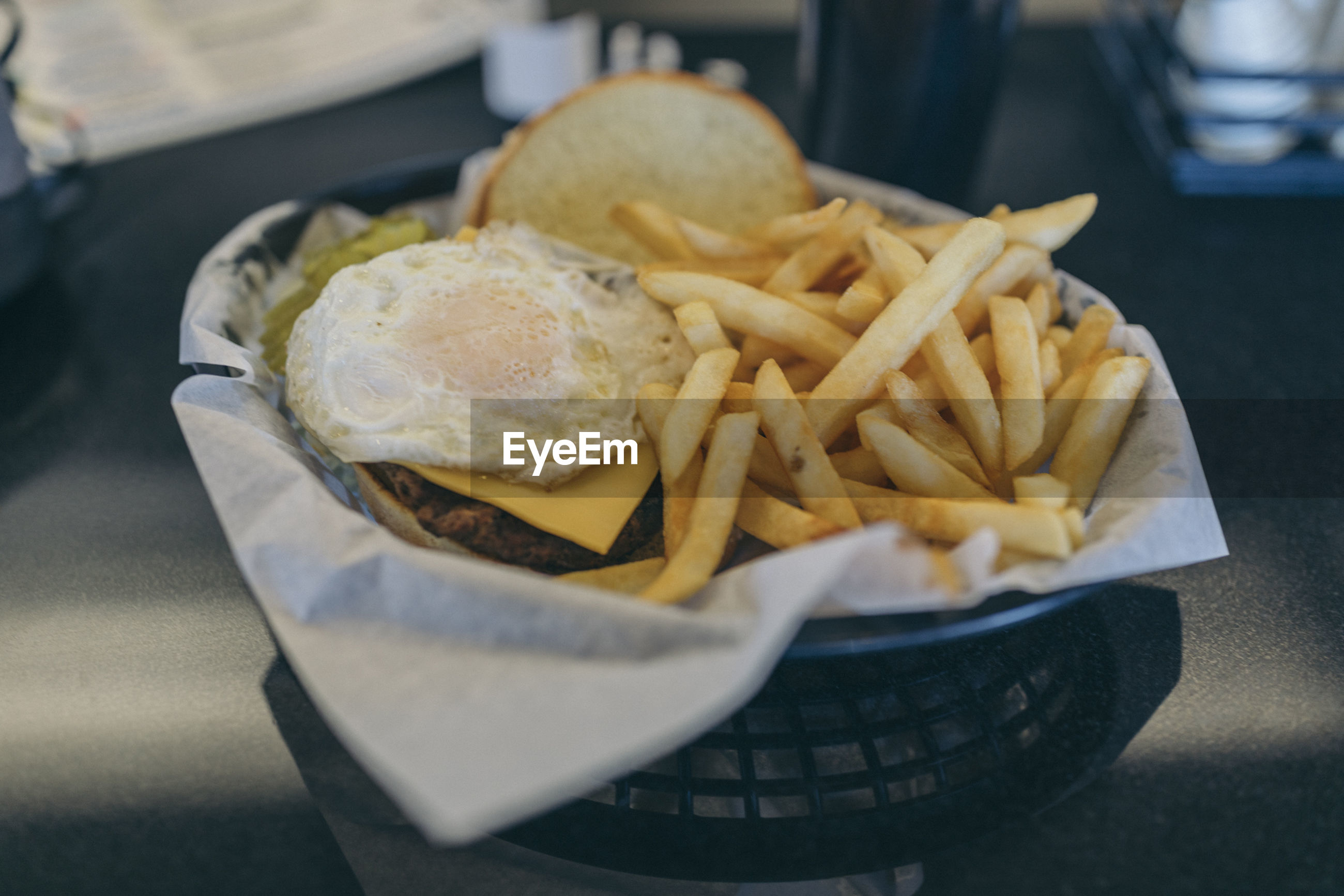Close-up of burger with fries
