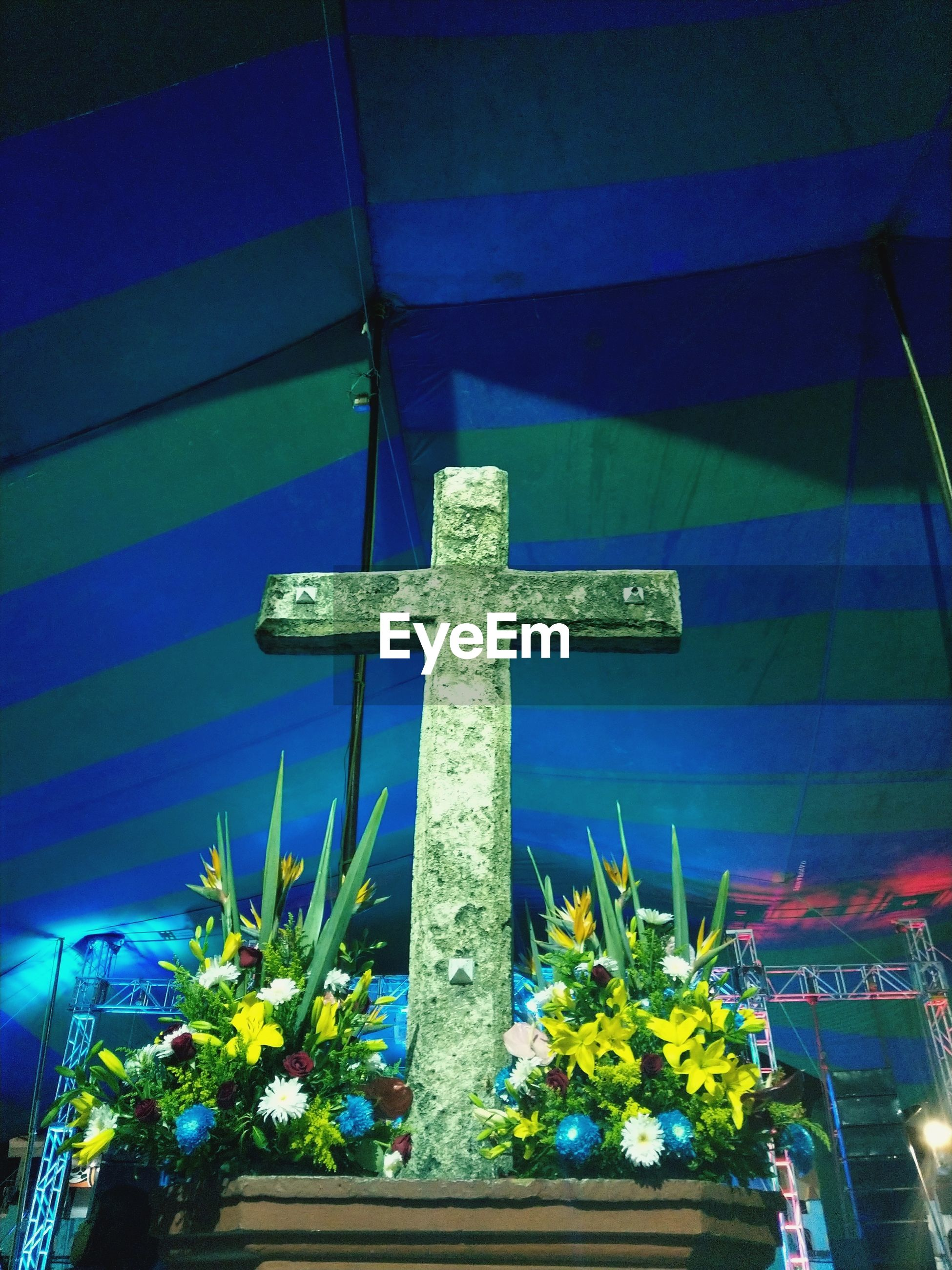 cross, religion, spirituality, crucifix, no people, low angle view, blue, memorial, day, flower, outdoors