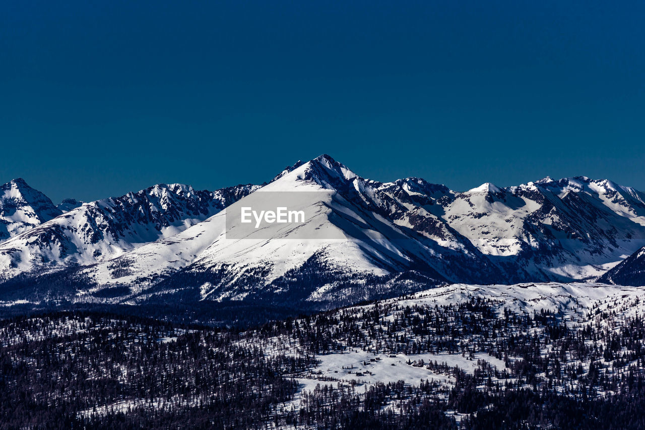 winter, cold temperature, snow, mountain, beauty in nature, sky, scenics - nature, snowcapped mountain, tranquil scene, mountain range, tranquility, clear sky, blue, nature, no people, environment, copy space, landscape, day, outdoors, mountain peak, range
