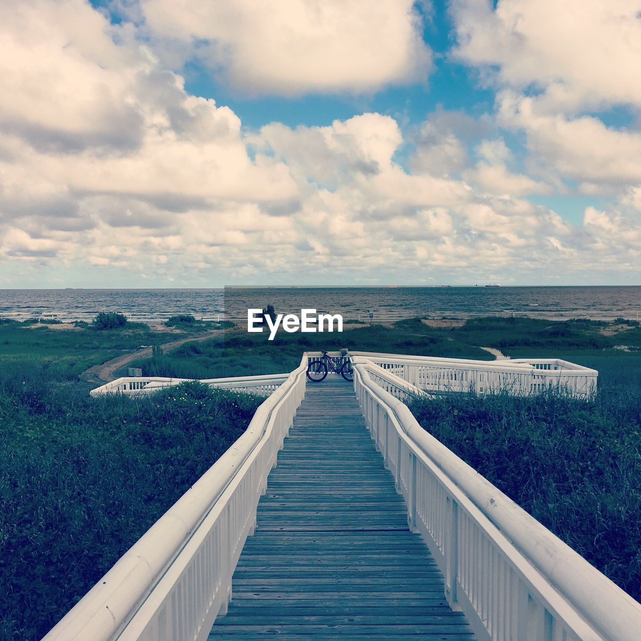 sky, cloud - sky, water, scenics, beauty in nature, tranquil scene, nature, sea, horizon over water, tranquility, railing, outdoors, day, the way forward, no people, architecture