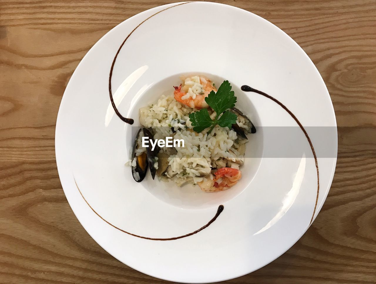 plate, table, ready-to-eat, food and drink, food, freshness, indoors, serving size, still life, healthy eating, wellbeing, directly above, high angle view, white color, wood - material, no people, close-up, meal, vegetable, indulgence, garnish, temptation, vegetarian food