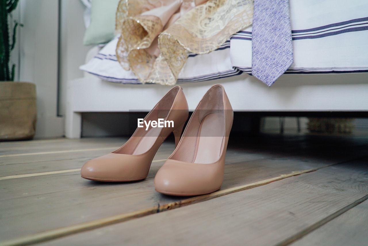 low section, human leg, shoe, indoors, women, high heels, adult, human body part, one person, flooring, real people, body part, hardwood floor, fashion, lifestyles, wood, day, females, wood - material, leisure activity, human foot, human limb