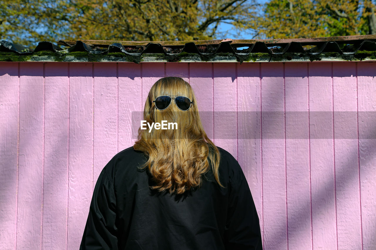 Rear View Of Woman Wearing Sunglasses On Head