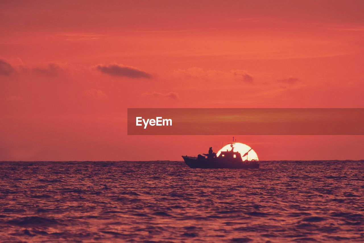 sea, water, sunset, sky, nautical vessel, waterfront, scenics - nature, horizon over water, horizon, transportation, beauty in nature, mode of transportation, cloud - sky, orange color, nature, no people, silhouette, tranquility, tranquil scene, outdoors, fishing boat