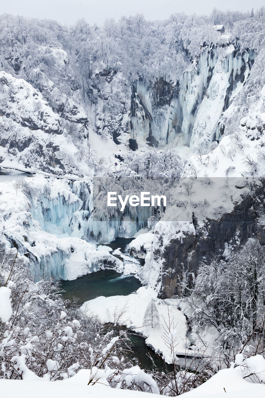 cold temperature, snow, winter, beauty in nature, environment, landscape, scenics - nature, ice, nature, frozen, tranquility, tranquil scene, day, mountain, no people, white color, water, glacier, outdoors, snowcapped mountain, iceberg, mountain peak, melting