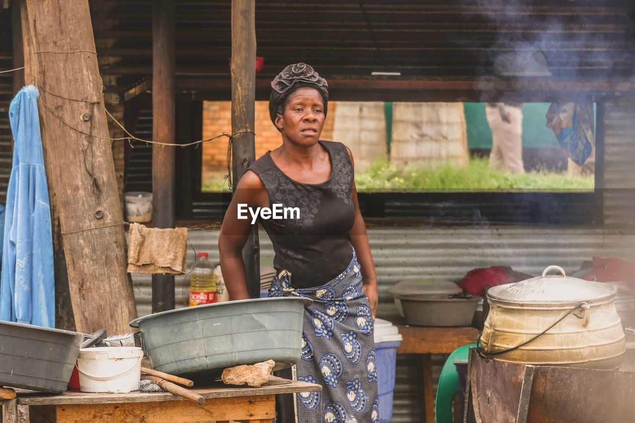 WOMAN WORKING AT MARKET STALL