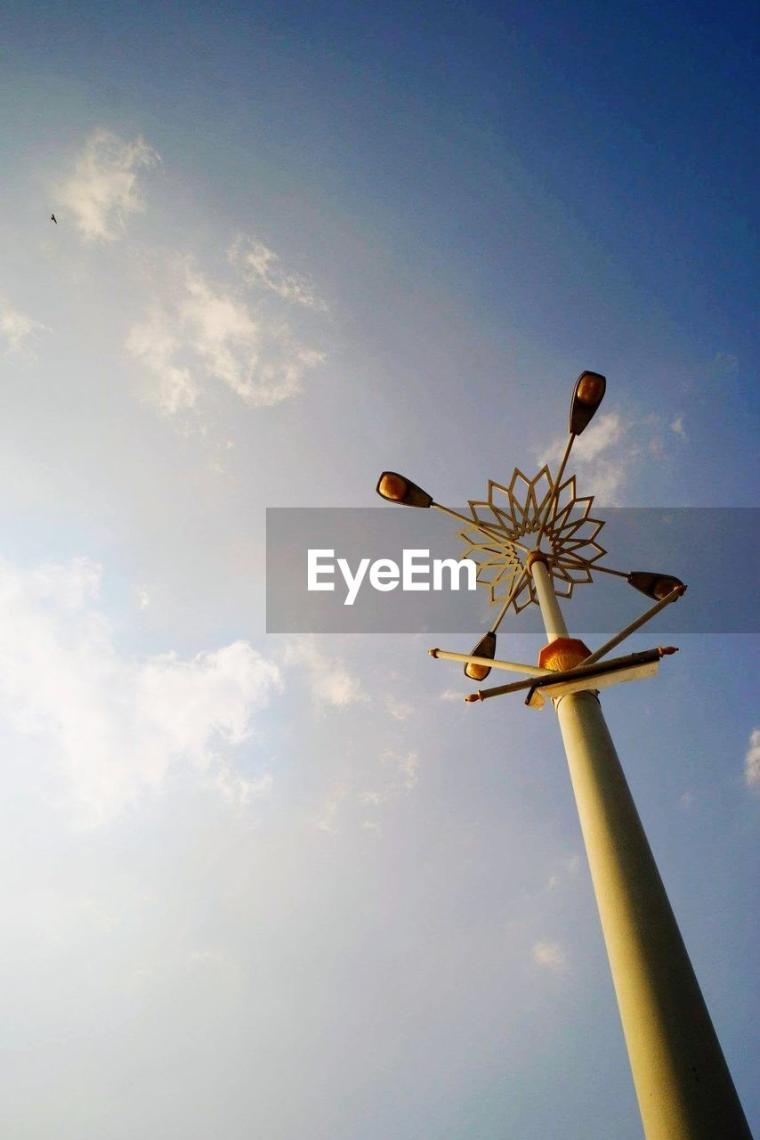 sky, low angle view, nature, cloud - sky, flower, flowering plant, fragility, beauty in nature, day, vulnerability, plant, no people, sunlight, outdoors, blue, freshness, growth, close-up, flying, plant stem