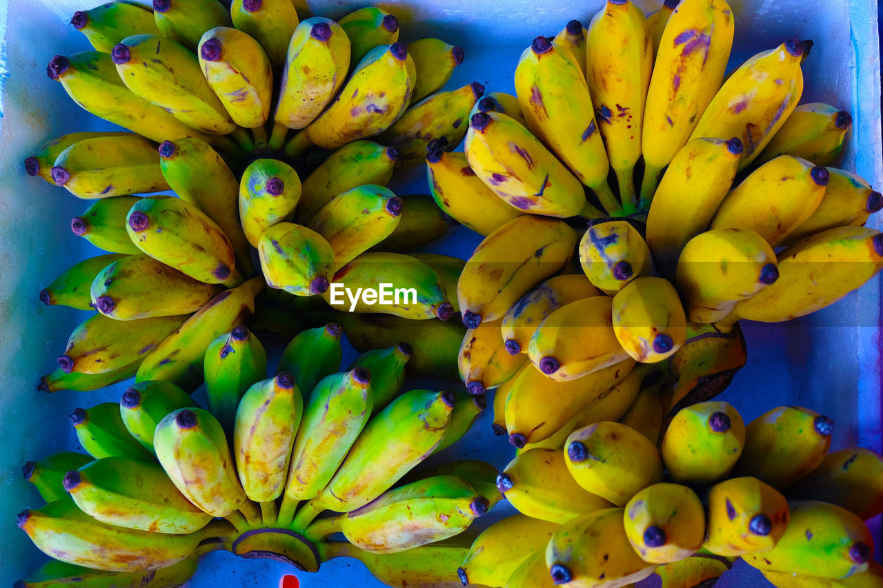healthy eating, fruit, banana, food and drink, wellbeing, food, freshness, yellow, large group of objects, no people, abundance, close-up, market, retail, for sale, market stall, directly above, full frame, bunch, day, ripe