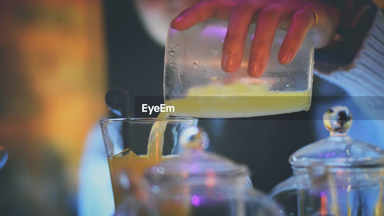Cropped image of bartender preparing drink