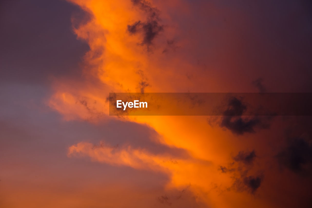 sky, cloud - sky, beauty in nature, orange color, sunset, scenics - nature, tranquility, tranquil scene, low angle view, idyllic, no people, nature, outdoors, dramatic sky, non-urban scene, full frame, backgrounds, majestic, cloudscape, meteorology, romantic sky